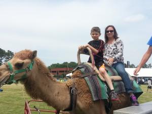 Michele Goldberg and her son, asdasd, enjoying a camel ride